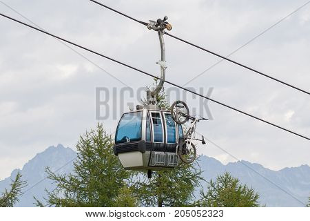 Ski Lift Cable Booth Or Car With A Mountainbike On The Side (unmarked)