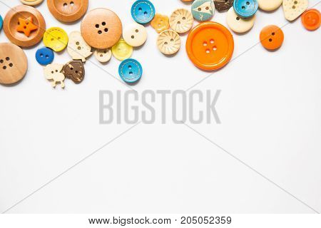 Beautiful colorful buttons on a white background. Beautiful handcraft composition. A button on a white background.