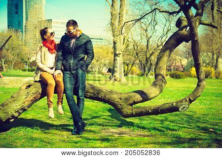 Romance beautiful relationship concept. Happy couple having romantic date in park during spring