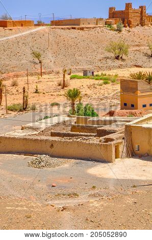 small village in a desert part of Morocco mud houses of bright saturated color