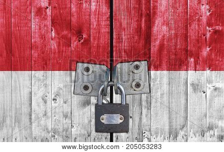 Malta flag on door with padlock close