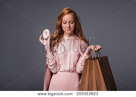 Lady With Donut And Shopping Bags