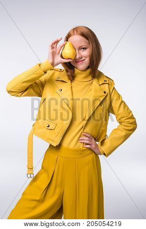 Stylish Girl In Yellow With Pear