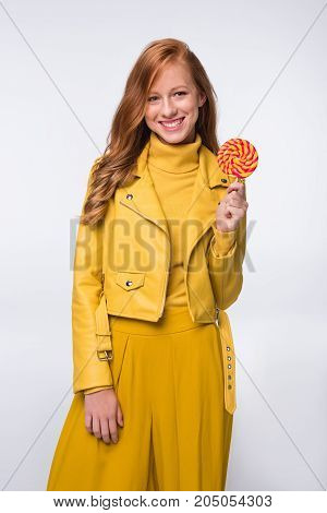 Girl In Yellow Leather Jacket With Lollipop
