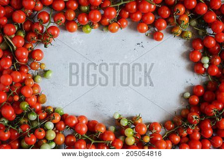 Vegetable spread of ripe cherry tomatoes on a light background. Flat lay. Bunch of cherry tamats