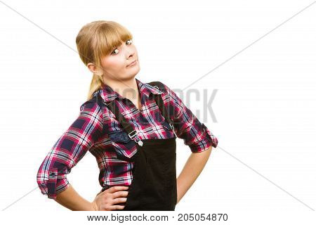 Gardening fahion concept. Attractive woman in pink check shirt and dungarees shocked surprised face expression. Isolated background