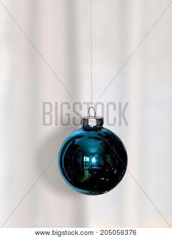 blue shining christmas tree ball bright background light reflection