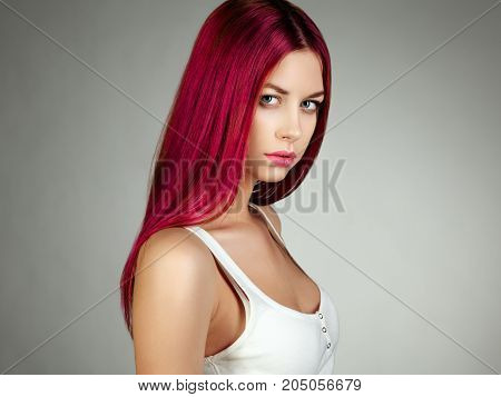 Beauty fashion model girl with colorful dyed hair. Girl with perfect makeup and hairstyle. Model brunette with perfect healthy dark hair