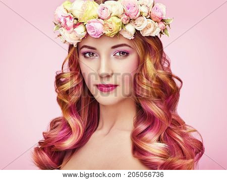 Beauty fashion model girl with colorful dyed hair. Girl with perfect makeup and hairstyle. Model with perfect healthy dyed hair. Flower wreath on head poster