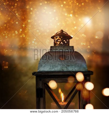 Golden abstract bokeh background with a lantern for christmas