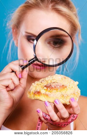 Woman With Magnifying Glass Examining Sweet Food
