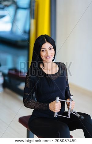 Attractive woman in the gym. The concept of a healthy lifestyle.