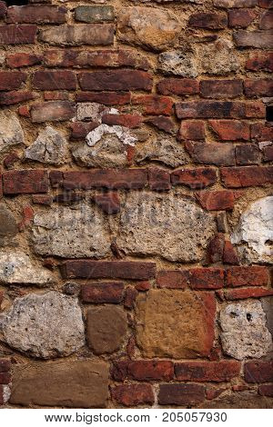 European Unusual Historic Detailed Red Yellow Brick Vintage Wall Of Old House Background. Closeup Po