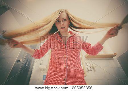 Woman Brushing Her Long Hair