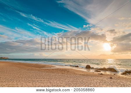 Sandy beach shoreline with clouds over sea at sunset South Australia