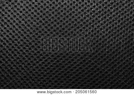Polyester texture. The breathable material. The holes for air. The back of the backpack
