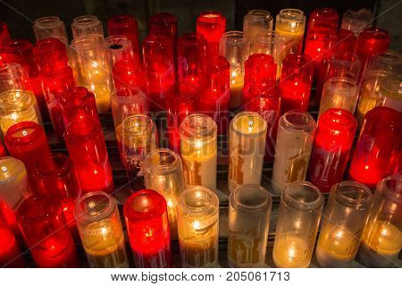yellow and red lighting candles in Basilica of the Sacred Heart of Paris in Montmartre