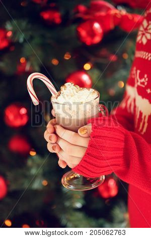 Girl Holding Cacao With Whipped Cream And Peppermint Candy Cane. Christmas Holiday Concept. Holiday