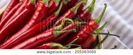 Red Hot Chilli Peppers In Wooden Bowl