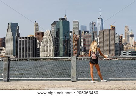 New York City, Usa, September 11, 2017 : Unidentified Young Woman Admires The View Of Manhattan Skyl