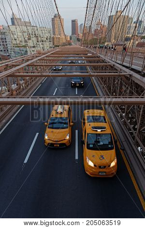 New York City, Usa, September 11, 2017 : Traffic On Brooklyn Bridge. The Brooklyn Bridge Is A Hybrid
