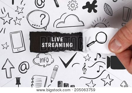 Business, Technology, Internet And Network Concept. Young Businessman Shows The Word: Live Streaming