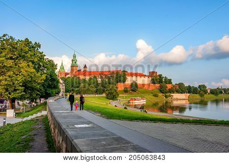 KRAKOW, POLAND - JUNE, 2012: City center with view of Wawel castle, popular tourist sight and and Vistula river