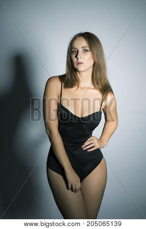 Oversized brunette model in black sexy body
