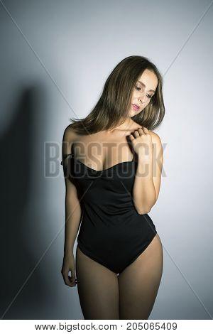 Elegant brunette oversized model, portrait studio shot