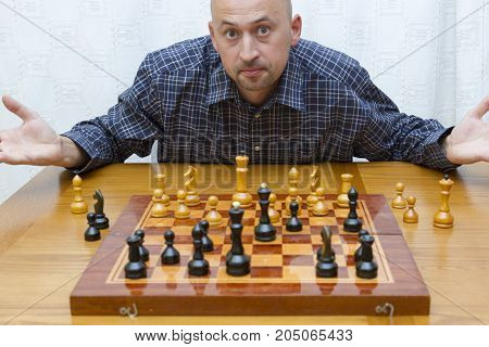 Man Thinking Over His Move In Chess
