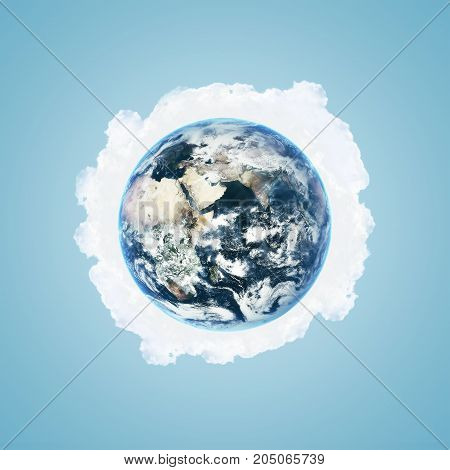 Illustration of world globe over white clouds and blue sky background. Elements of this image furnished by NASA