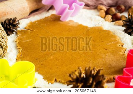 Christmas baking background with gingerbread man cutters and decorations