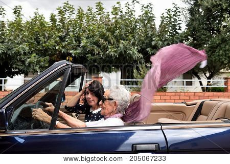 An Old Woman Who Goes Fast With The Car And The Young Woman Suffers