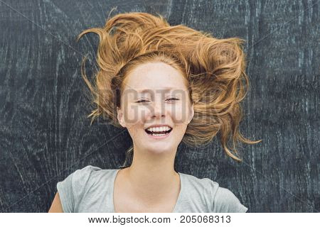 Top View Of A Young Woman With Space For Text And Symbols On The Old Wooden Background. Concept For