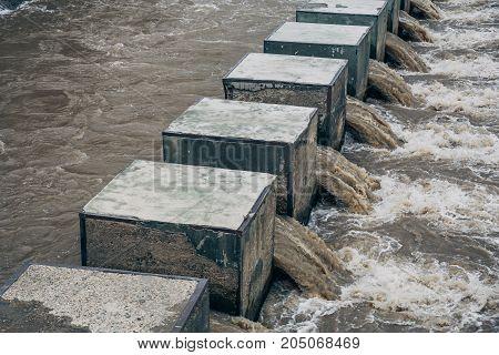 Water rushing through dam in hydro power plant