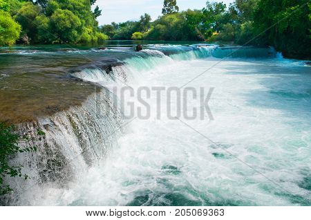 Amazing view of Manavgat waterfall in Antalya, Turkey. Sunset day.
