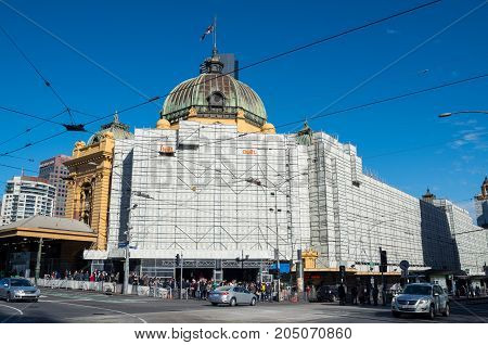 Melbourne Australia - July 29 2017: Flinders Street Station is covered in scaffolding for a major 100 million dollar redevelopment. Flinders Street Station is a major urban train station.