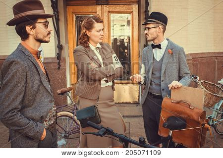 KYIV, UKRAINE - SEP 17, 2017: Woman and man in vintage clothing talking about fashion at the cosplay festival Retro Cruise on September 17, 2017. Kiev is the 8th most populous city in Europe.