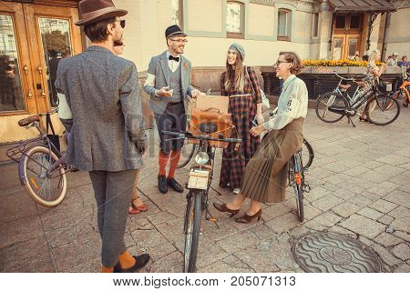 KYIV, UKRAINE - SEP 17, 2017: Group of happy women and men in vintage clothing talking about fashion at cosplay festival Retro Cruise on September 17, 2017. Kiev is the 8th most populous city in Europe
