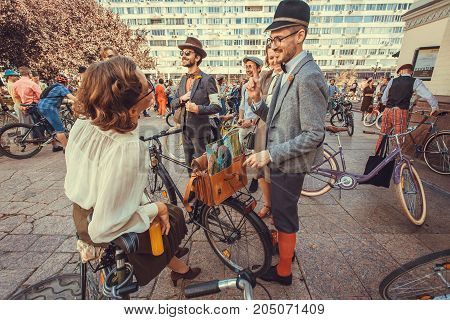 KYIV, UKRAINE - SEP 17, 2017: Funny group of women and men in vintage clothing talking about fashion at cosplay festival Retro Cruise on September 17, 2017. Kiev is the 8th most populous city in Europe
