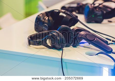 Virtual Reality Glasses And Headphones On The Table