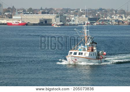 Fairhaven Massachusetts USA - November 1 2006: Fishing vessel Jim Dandy with New Bedford in background