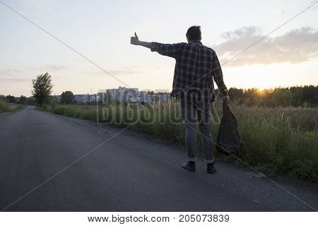 A man hitchhiking travel adventure discover discoverer