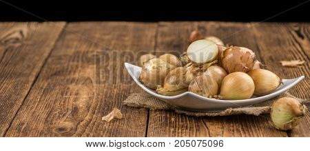 Portion Of White Onions On Wooden Background, Selective Focus