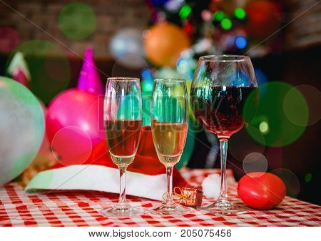 The three of wine glass on the table in Christmas Party or Happy New Year Party.