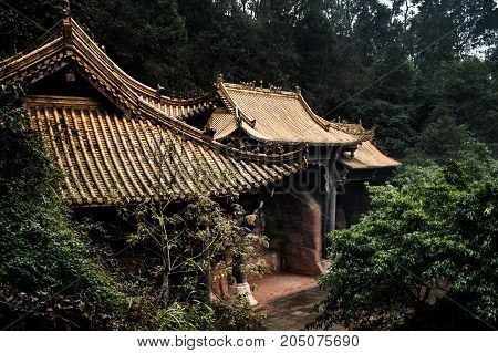Roofs of houses in Chinese style. View of the old roofs of houses covered with tiles. Leshan Shi, China, Asia