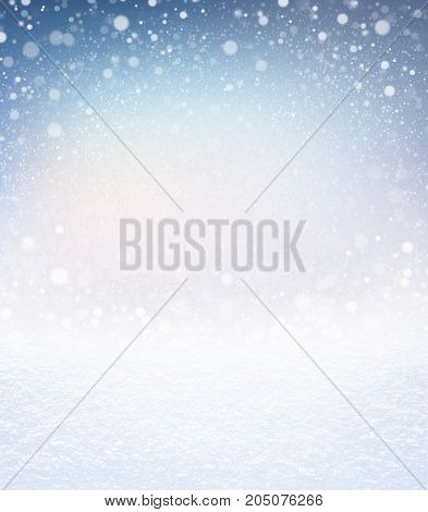Snowfall on a winter blue iced background