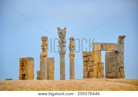 ruins of the ancient Persepolis stone columns and sculptures which were decoration of the ancient ancient settlement