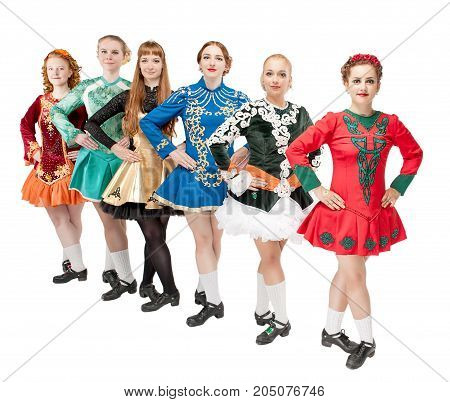 Group of beautiful women in dresses for Irish dance isolated on white