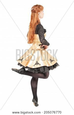 Beautiful woman in dress for Irish dance and mask dancing isolated on white